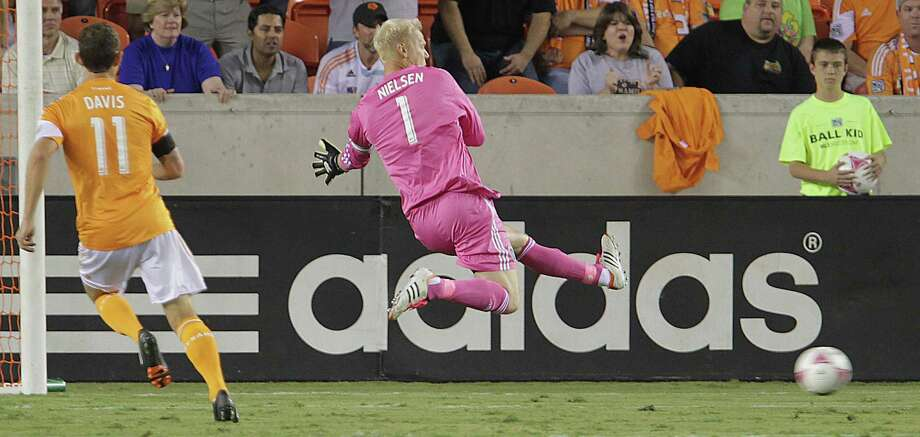 Sporting KC goalkeeper Jimmy Nielsen  (1) goes after the ball  during the first half of MLS game action at BBVA Compass Stadium Wednesday, Oct. 9, 2013, in Houston. Photo: James Nielsen, Houston Chronicle / © 2013  Houston Chronicle