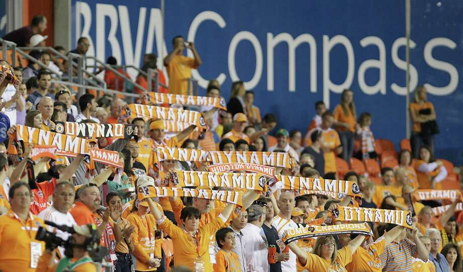 Houston Dynamo fans cheer during the player introductions as the Houston Dynamo face the Sporting KC at BBVA Compass Stadium Wednesday, Oct. 9, 2013, in Houston. Photo: James Nielsen, Houston Chronicle / © 2013  Houston Chronicle