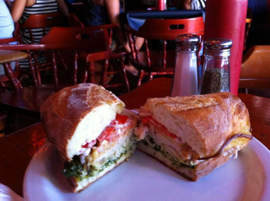 Honey Hole: A casual place full of hipsters, beer, dark wood, and tasty sandwiches. Pictured is the $8 Waverider, with house-roasted turkey, pesto, aioli, smoked gouda, onions and Mama Lil's sweet hot peppers. It's good. 