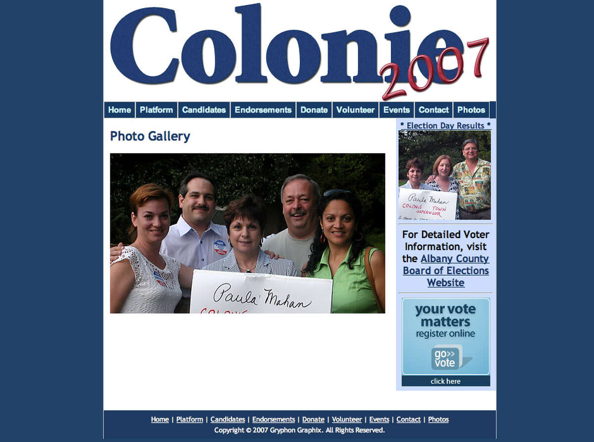 Colonie's ethics chairman, Robert Tengeler, is pictured in the photo on the right, which was posted on a 2007 pro-Democrat party website and includes Paula Mahan, the current supervisor. Tengeler is the local authority on conflicts of interest, but he also works for a law firm that does business with the town and is chair of the local economic development authority. (Colonie Democrat's 2007 website)