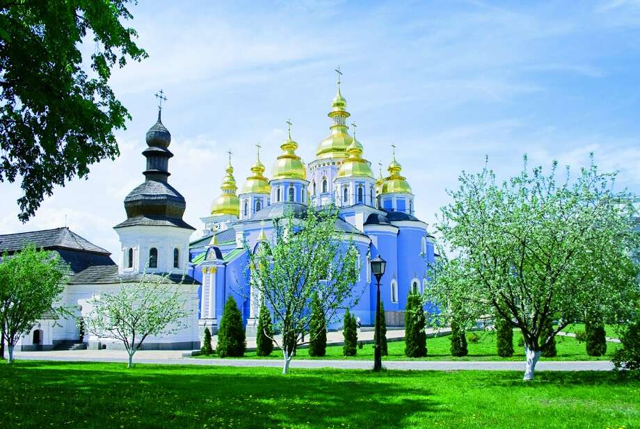 "SPRING | Kiev, UkraineFounded during the early 12th century, Kiev'€™s St. Michael€'s Cathedral—€""devoted to the city'€™s patron saint€—kicked off the trend of gilding domes.  (From National Geographic's 'Four Seasons of Travel') Photo: Kiyanochka, IStockphoto"
