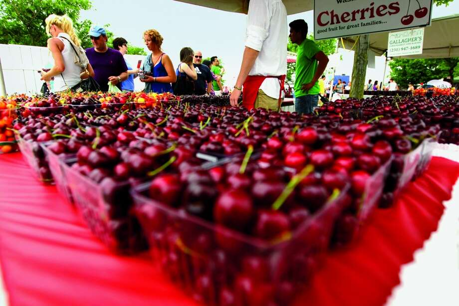 "SUMMER | Traverse City, Michigan  Though the area is famous for its tart cherries, Traverse City—and its National Cherry Festival—€""also welcome fans of the fruit's sweet varieties.  (From National Geographic's 'Four Seasons of Travel') Photo: Keith King, AP Images/The Record-Eagle"