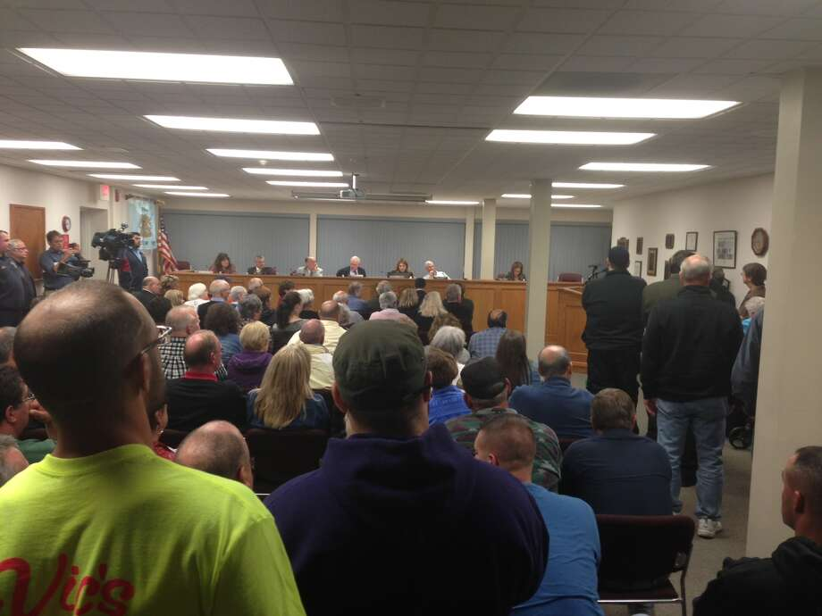 More than 200 Rotterdam residents clamor for answers about an ambulance plan Wednesday night. Many gave personal testimony about the current service's value. (Paul Nelson / Times Union)