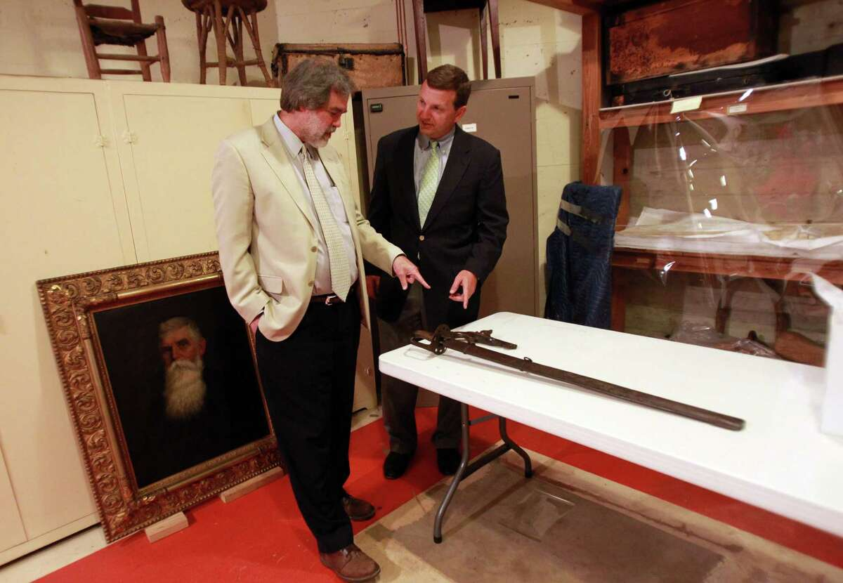 Spasic, left, and Chad H. Muir, treasurer of the San Jacinto Museum of History, look forward to being able to place Santa Anna's sword on exhibit. The weapon, on extended loan, now lies out of sight in the monument's artifact holding area.