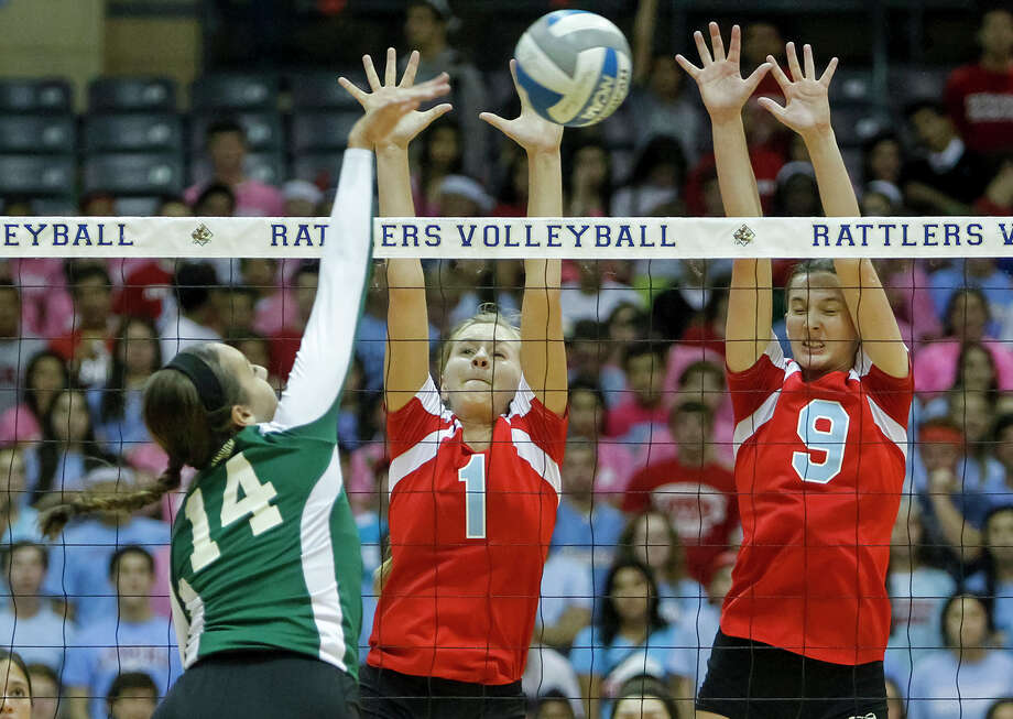 Incarnate Word's Krystal Puente (left) tries to shoot between Antonian's Sarah Bell (center) and Carice Pfeiffer during their match at Grehey Arena on Wednesday, Oct. 9, 2013.  MARVIN PFEIFFER/ mpfeiffer@express-news.net Photo: Marvin Pfeiffer, San Antonio Express-News / Express-News 2013