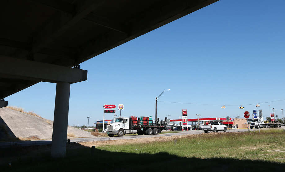 A Conoco station and a Burger King restaurant, two of the three businesses the community says it needs to survive, can be seen in this view of the Sandy Oaks area. Photo: Jerry Lara / San Antonio Express-News