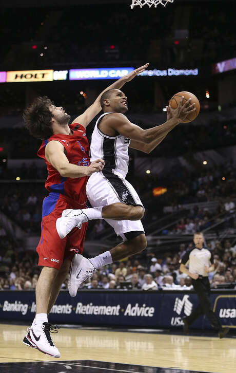San Antonio Spurs' Patty Mills drives for two against CSKA Moscow Milos Teodosic during the second half of an exhibition game at the AT&T Center on Wednesday, Oct. 9, 2013. The Spurs won in overtime Photo: San Antonio Express-News