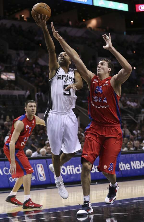 San Antonio Spurs' Tony Parker shoots as CSKA Moscow's Sasha Kaun defends during the first half of an exhibition game at the AT&T Center on Wednesday, Oct. 9, 2013. Photo: Jerry Lara, San Antonio Express-News