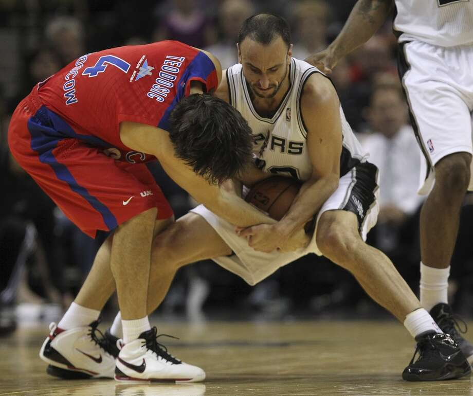 San Antonio Spurs' Manu Ginobili ties up the ball for a jump ball against CSKA Moscow Milos Teodosic during the first half of an exhibition game at the AT&T Center on Wednesday, Oct. 9, 2013. Photo: Jerry Lara, San Antonio Express-News