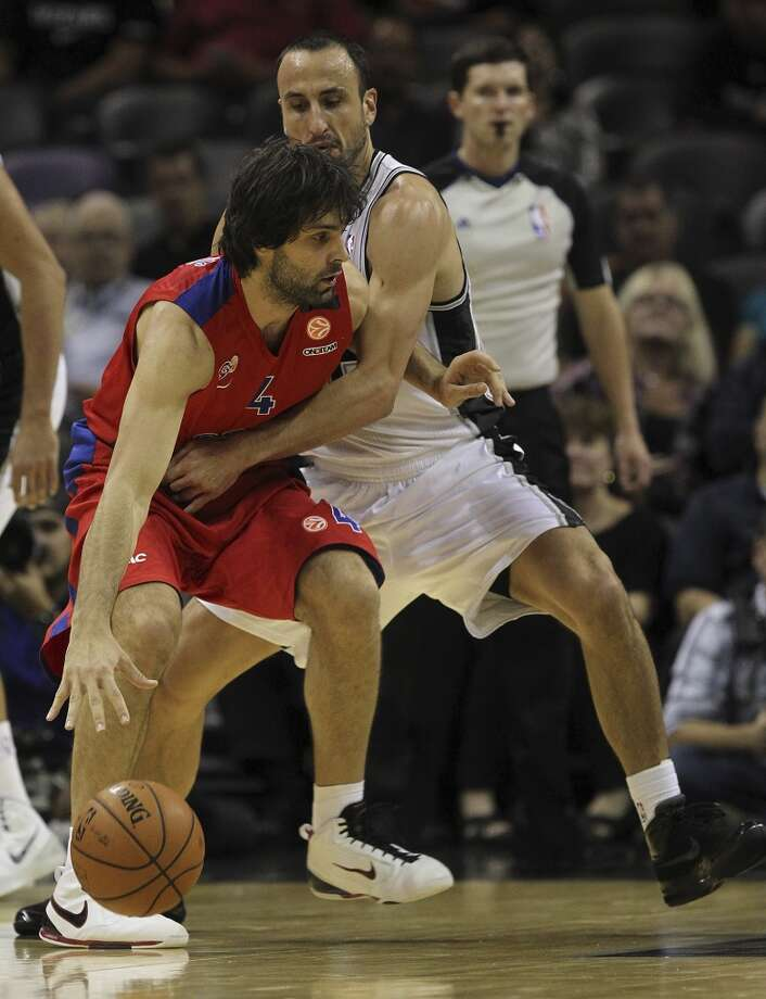 San Antonio Spurs' Manu Ginobili puts pressure on CSKA Moscow Milos Teodosic during the first half of an exhibition game at the AT&T Center on Wednesday, Oct. 9, 2013. Photo: Jerry Lara, San Antonio Express-News