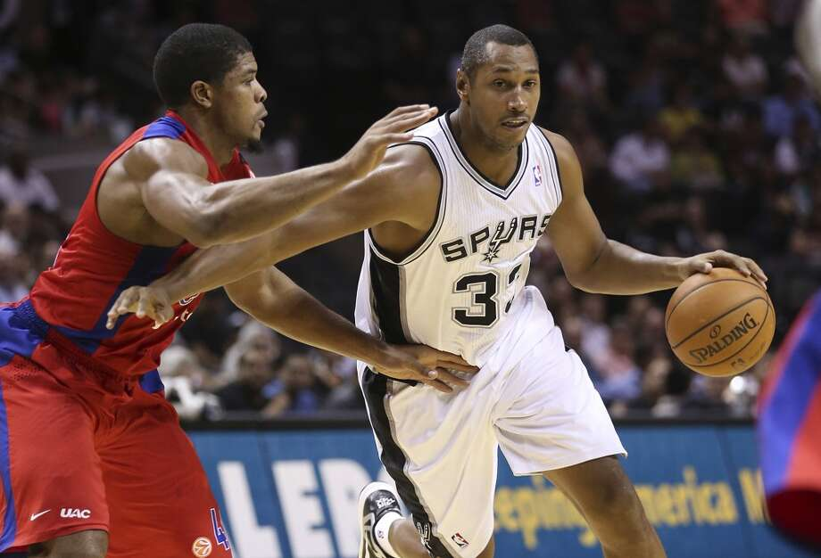 San Antonio Spurs' Boris Diaw keeps CSKA Moscow Kyle Hines away from the ball during the first half of an exhibition game at the AT&T Center on Wednesday, Oct. 9, 2013. Photo: Jerry Lara, San Antonio Express-News