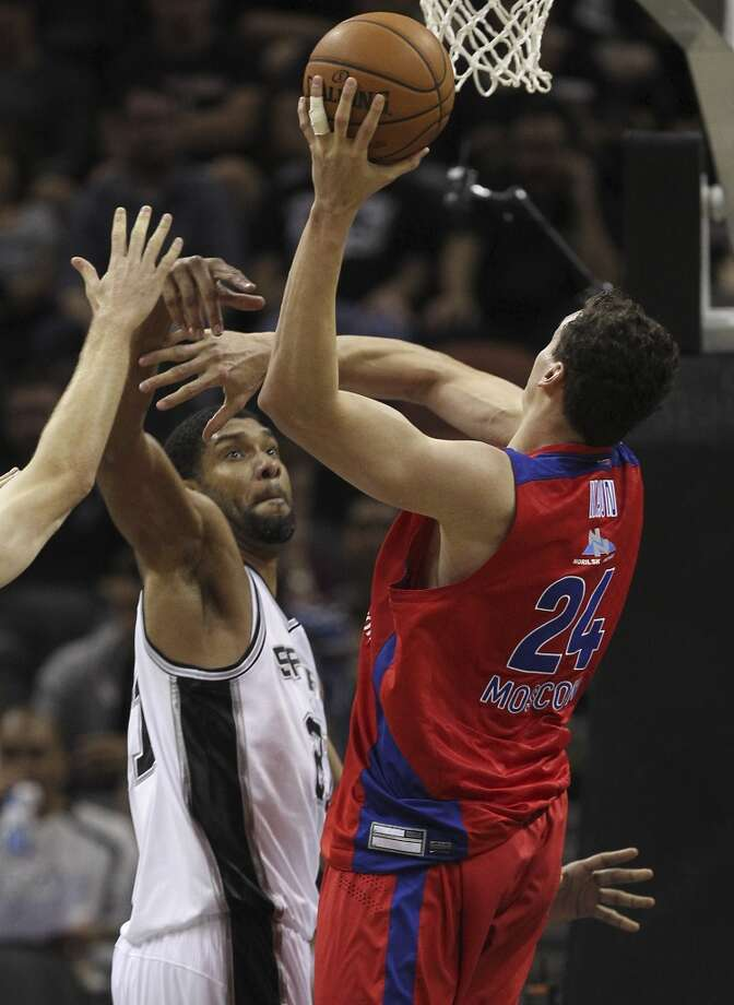 San Antonio Spurs' Tim Duncan defends against CSKA Moscow Sasha Kaun during the first half of an exhibition game at the AT&T Center on Wednesday, Oct. 9, 2013. Photo: Jerry Lara, San Antonio Express-News