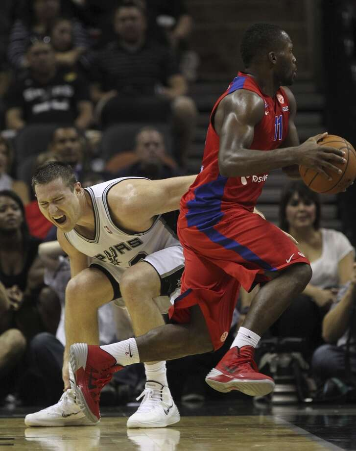 San Antonio Spurs' Aron Baynes reacts while trying to keep up with CSKA Moscow Jeremy Pargo during the second half of an exhibition game at the AT&T Center on Wednesday, Oct. 9, 2013. The Spurs won in overtime 95-93. Photo: Jerry Lara, San Antonio Express-News