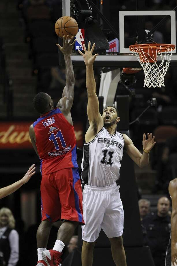 San Antoino Spurs' Jeff Ayres tries to defend against CSKA Moscow Jeremy Pargo during the second half of an exhibition game at the AT&T Center on Wednesday, Oct. 9, 2013. The Spurs won in overtime 95-93. Photo: Jerry Lara, San Antonio Express-News