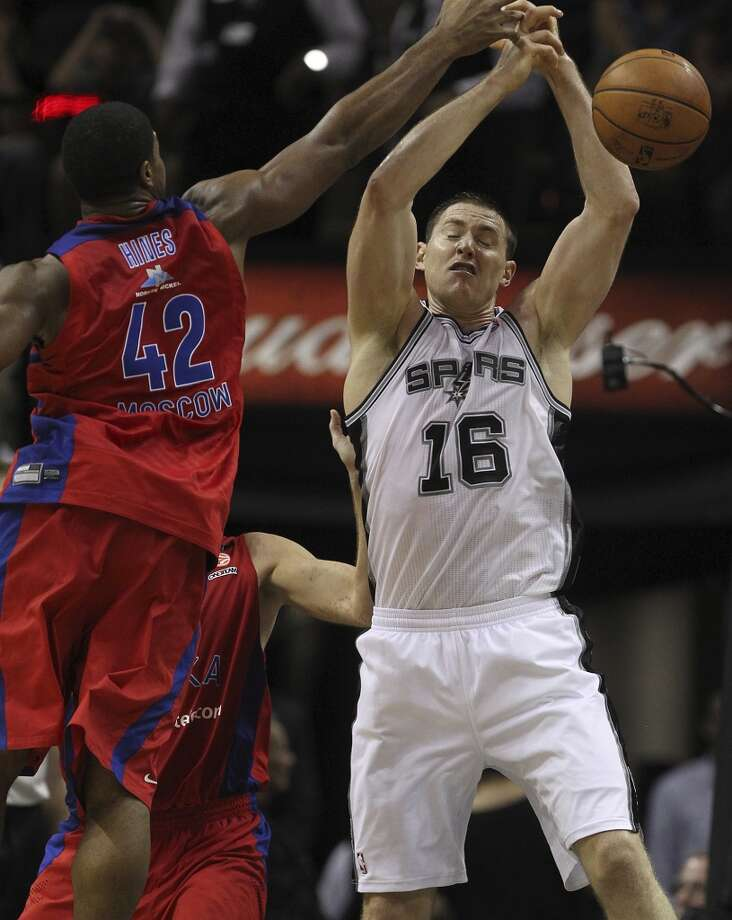 San Antonio Spurs' Aron Baynes misses a rebound under pressure from CSKA Moscow Kyle Hines during the second half of an exhibition game at the AT&T Center on Wednesday, Oct. 9, 2013. The Spurs won in overtime 95-93. Photo: Jerry Lara, San Antonio Express-News