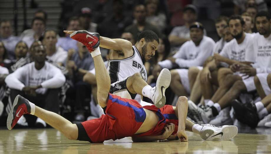 San Antoino Spurs' Jeff Ayres and CSKA Moscow Vitaly Fridzon collide during the second half of an exhibition game at the AT&T Center on Wednesday, Oct. 9, 2013. The Spurs won in overtime 95-93. Photo: Jerry Lara, San Antonio Express-News