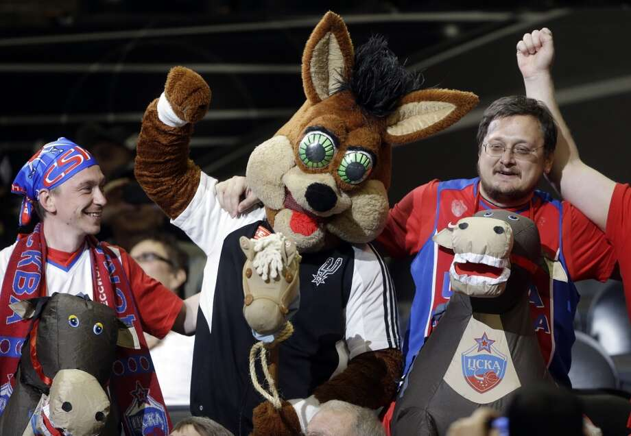 San Antonio Spurs mascot, Coyote, center, jokes with CSKA Moscow fans during the second half of an exhibition NBA basketball game against the San Antonio Spurs, Wednesday, Oct. 9, 2013, in San Antonio. San Antonio won 95-93 in overtime. Photo: Eric Gay, Associated Press
