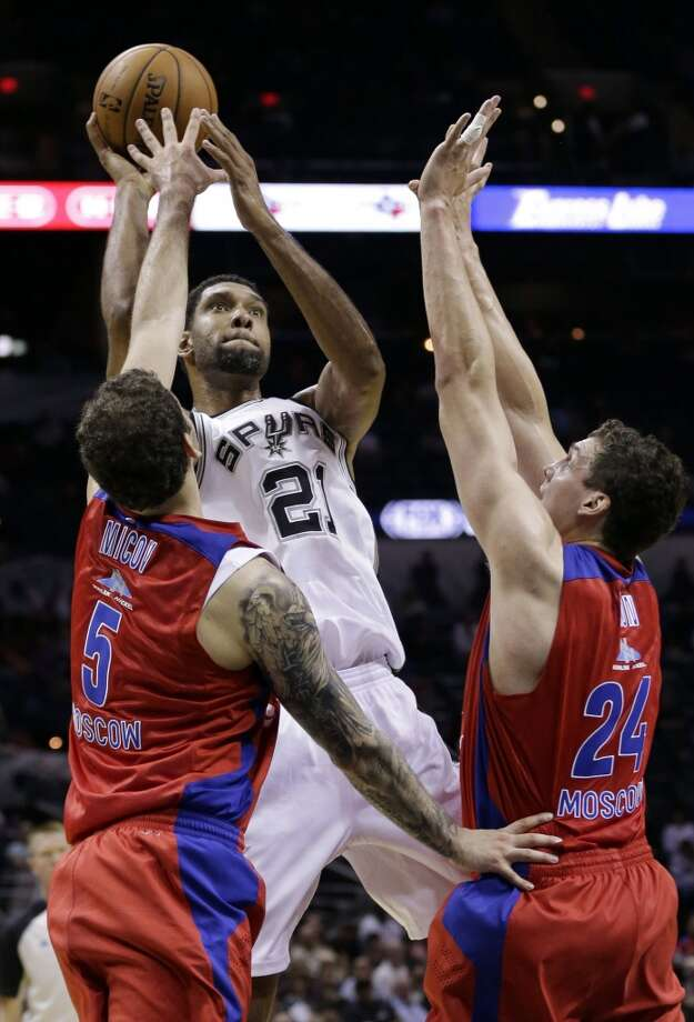 San Antonio Spurs' Tim Duncan (21) shoots over CSKA Moscow's Vladimir Micov (5) and Sasha Kaun (24) during the first half of an exhibition NBA basketball game, Wednesday, Oct. 9, 2013, in San Antonio. Photo: Eric Gay, Associated Press