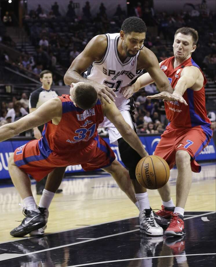 San Antonio Spurs' Tim Duncan, center, is defended by CSKA Moscow's Victor Khryapa (31) and Vitaly Fridzon during the first half of an exhibition NBA basketball game, Wednesday, Oct. 9, 2013, in San Antonio. Photo: Eric Gay, Associated Press