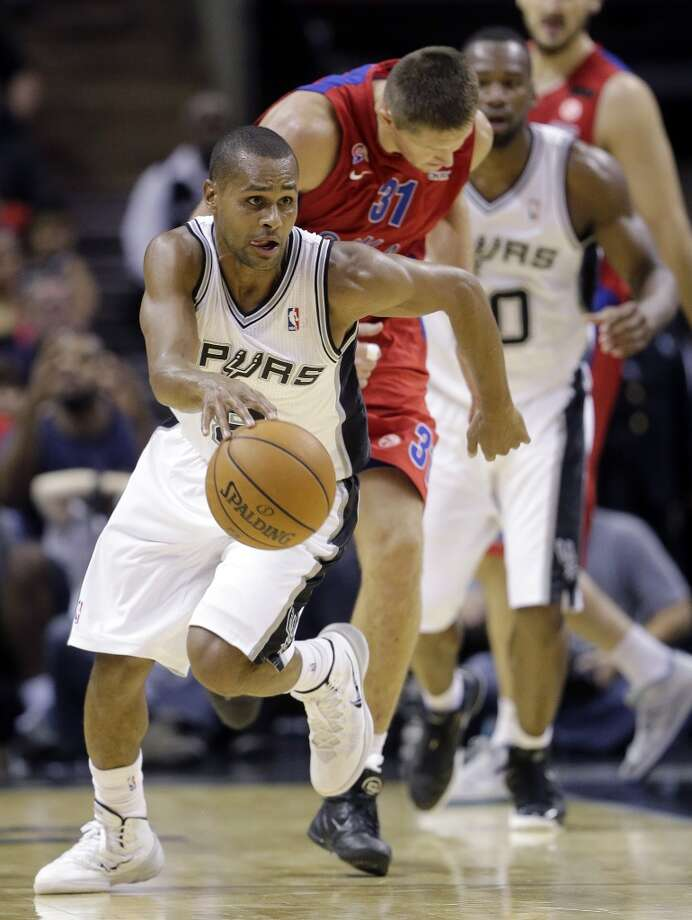 San Antonio Spurs' Patty Mills, left, of Australia, races upcourt as CSKA Moscow's Victor Khryapa (31) pursues after he stole the ball during the second half of an exhibition NBA basketball game Wednesday, Oct. 9, 2013, in San Antonio. San Antonio won 95-93 in overtime. Photo: Eric Gay, Associated Press