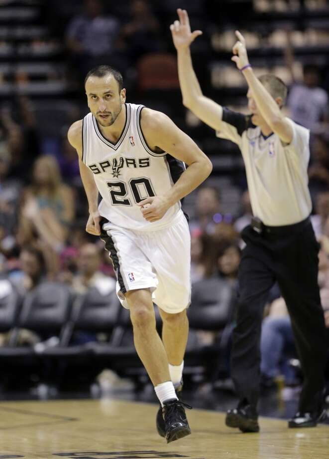 San Antonio Spurs' Manu Ginobili, of Argentina, runs up court after scoring against CSKA Moscow during the second half of an exhibition NBA basketball game, Wednesday, Oct. 9, 2013, in San Antonio. San Antonio won 95-93 in overtime. Photo: Eric Gay, Associated Press