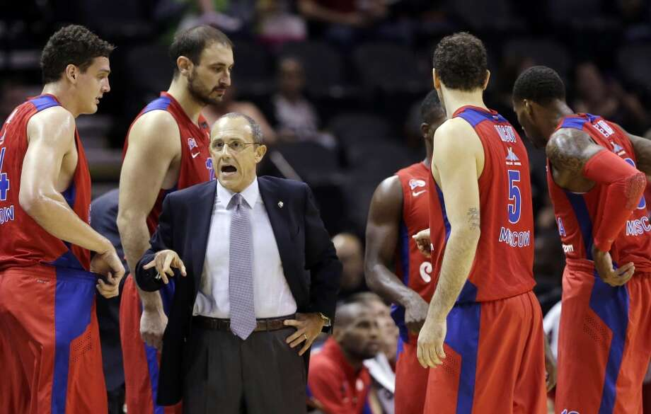 CSKA Moscow coach Ettore Messina, center, talks to his team during a timeout in the second half of an exhibition NBA basketball game against the San Antonio Spurs, Wednesday, Oct. 9, 2013, in San Antonio. San Antonio won 95-93 in overtime. Photo: Eric Gay, Associated Press
