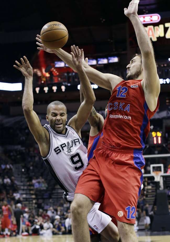 San Antonio Spurs' Tony Parker (9), of France, is fouled by CSKA Moscow's Nedad Krstic as he drives to the basket during the first half of an preseason NBA basketball game, Wednesday, Oct. 9, 2013, in San Antonio. Photo: Eric Gay, Associated Press