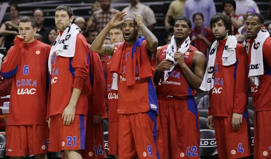 CSKA Moscow's Aaron Jackson (9) and teammates react as the San Antonio Spurs tie the game on a last-second score to send the exhibition NBA basketball game into overtime, Wednesday, Oct. 9, 2013, in San Antonio. San Antonio won 95-93. Photo: Eric Gay, Associated Press