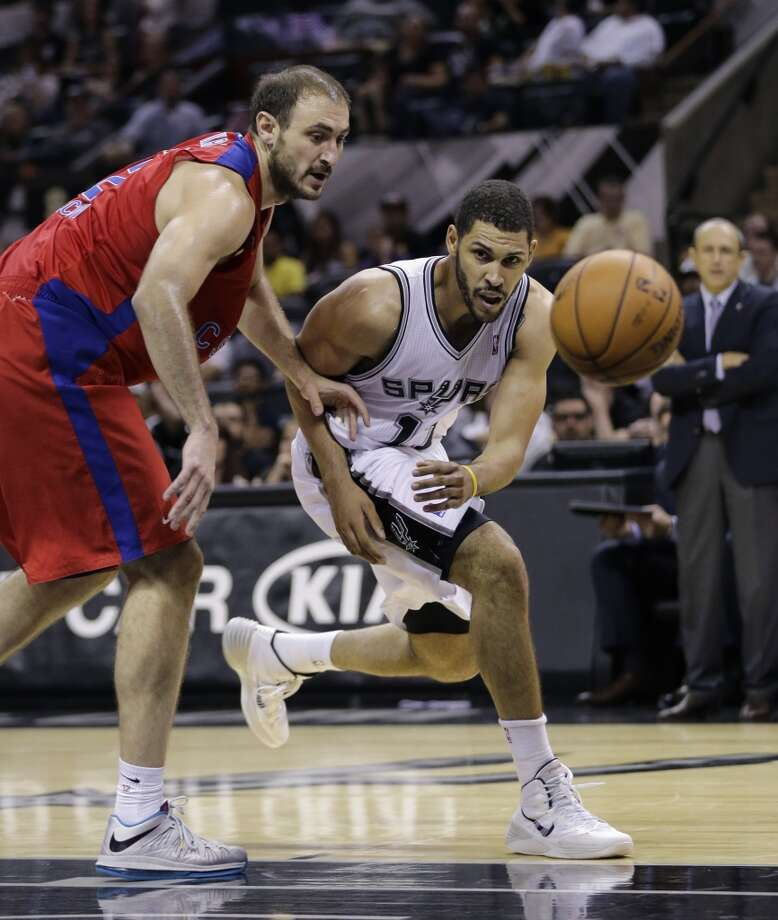 San Antonio Spurs' Jeff Ayres, right, and CSKA Moscow's Nedad Krstic, left, chase a loose ball during the second half of an exhibition NBA basketball game, Wednesday, Oct. 9, 2013, in San Antonio. San Antonio won 95-93 in overtime. Photo: Eric Gay, Associated Press