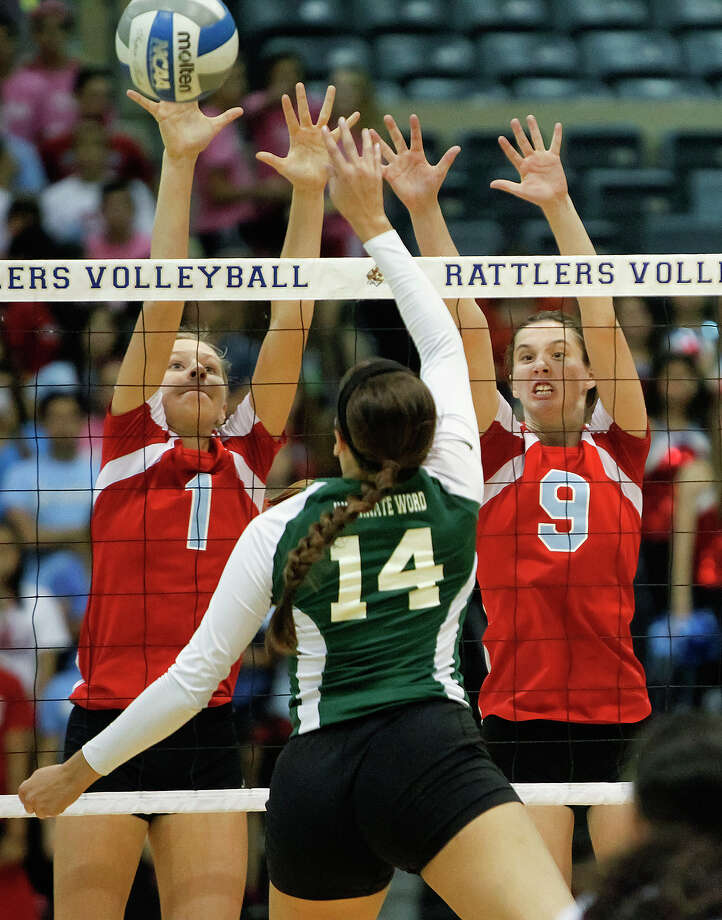 Antonian's Sarah Bell (left) and Carice Pfeiffer go up to block a shot by Incarnate Word's Krystal Puente during the first set of their match  at Grehey Arena on Wednesday, Oct. 9, 2013.  MARVIN PFEIFFER/ mpfeiffer@express-news.net Photo: Marvin Pfeiffer, San Antonio Express-News / Express-News 2013