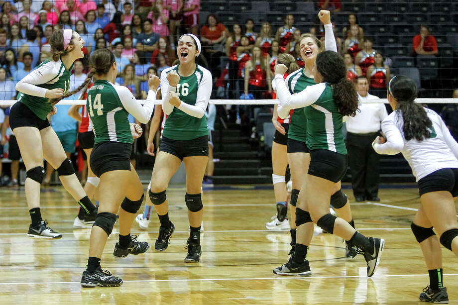 The Incarnate Word Lady Shamrocks celebrate a point during their match with Antonian at Grehey Arena on Wednesday, Oct. 9, 2013.  MARVIN PFEIFFER/ mpfeiffer@express-news.net Photo: Marvin Pfeiffer, San Antonio Express-News / Express-News 2013