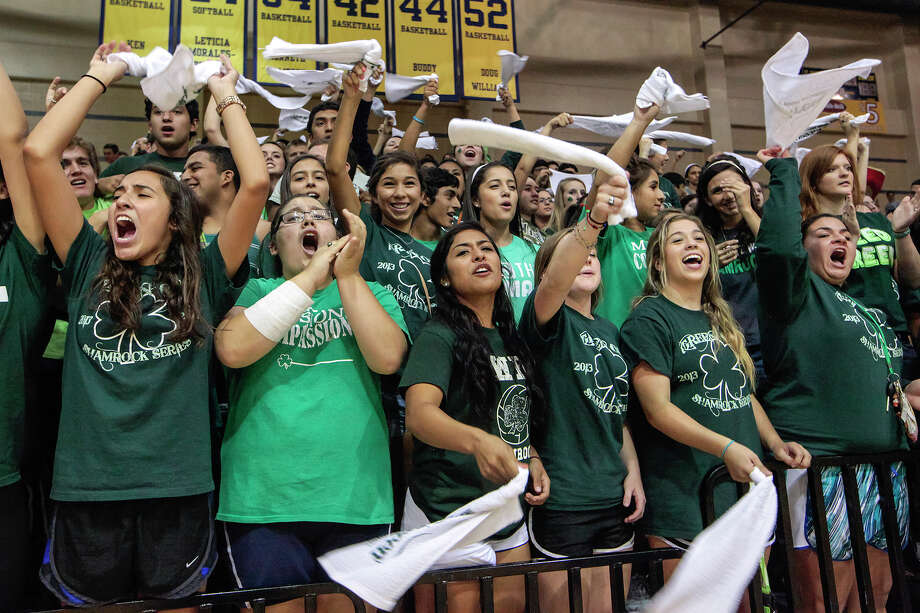 Incarnate Word students cheer for the Lady Shamrocks during their match with Antonian at Grehey Arena on Wednesday, Oct. 9, 2013.  MARVIN PFEIFFER/ mpfeiffer@express-news.net Photo: Marvin Pfeiffer, San Antonio Express-News / Express-News 2013