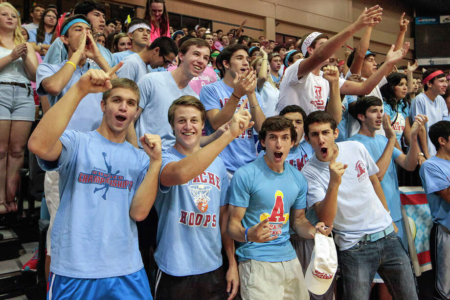 Antonian students cheer during player introductions prior to their volleyball match with Incarnate Word at Grehey Arena on Wednesday, Oct. 9, 2013.  MARVIN PFEIFFER/ mpfeiffer@express-news.net Photo: Marvin Pfeiffer, San Antonio Express-News / Express-News 2013