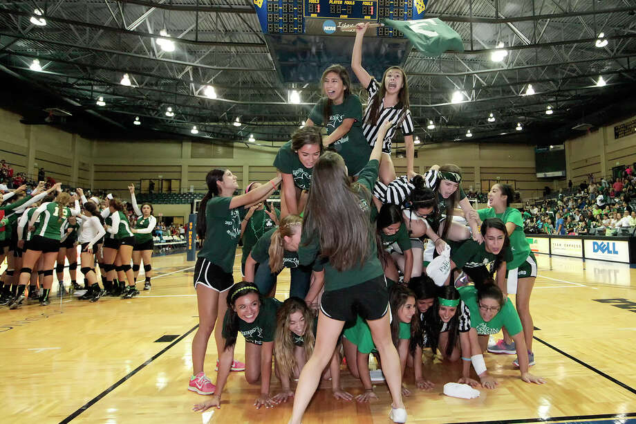 Incarnate Word students build a pyramid during a time out in their match with Antonian  at Grehey Arena on Wednesday, Oct. 9, 2013.  MARVIN PFEIFFER/ mpfeiffer@express-news.net Photo: Marvin Pfeiffer, San Antonio Express-News / Express-News 2013