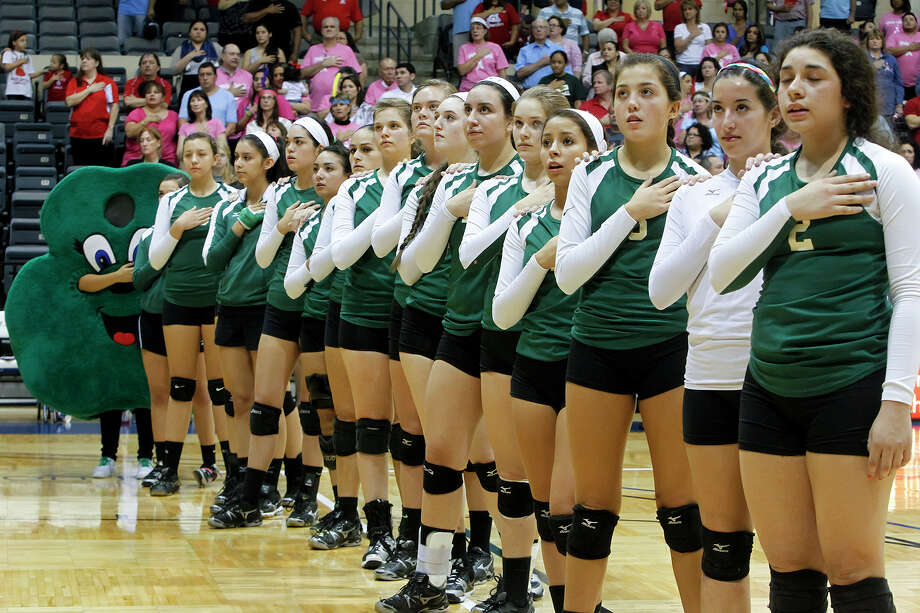 The Incarnate Word Lady Shamrocks stand at attention as the National Anthem is sung prior to their match with Antonian at Grehey Arena on Wednesday, Oct. 9, 2013.  MARVIN PFEIFFER/ mpfeiffer@express-news.net Photo: Marvin Pfeiffer, San Antonio Express-News / Express-News 2013