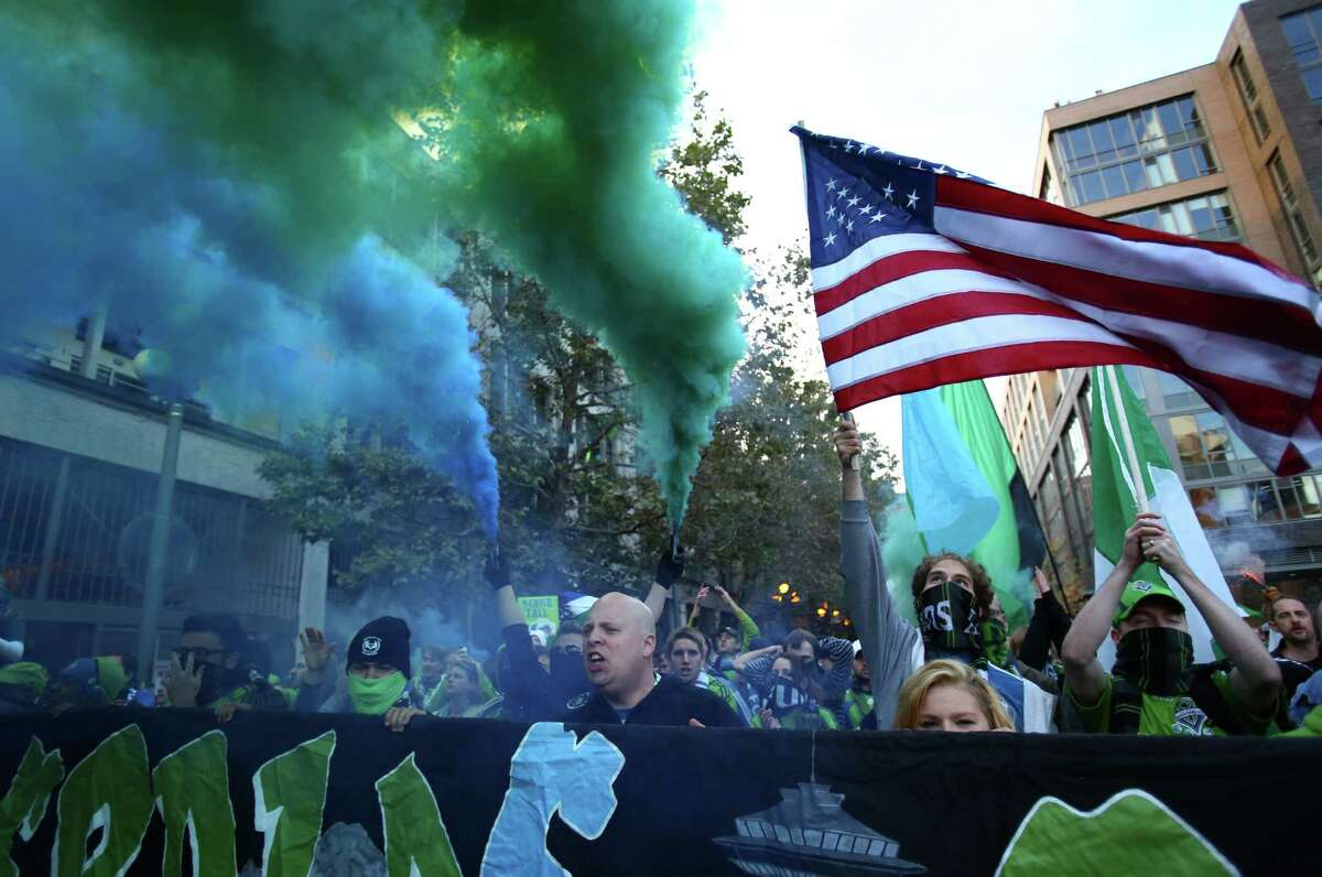 Seattle Sounders fans march to the match against the Vancouver Whitecaps on Wednesday, October 9, 2013 at CenturyLink Field in Seattle.