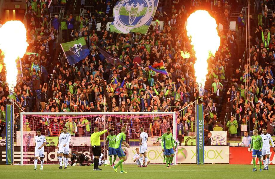 Flames erupt after Seattle Sounders player Mauro Rosales scored a goal against the Vancouver Whitecaps in the second half of a match Wednesday, October 9, 2013 at CenturyLink Field in Seattle. Photo: JOSHUA TRUJILLO, SEATTLEPI.COM / SEATTLEPI.COM