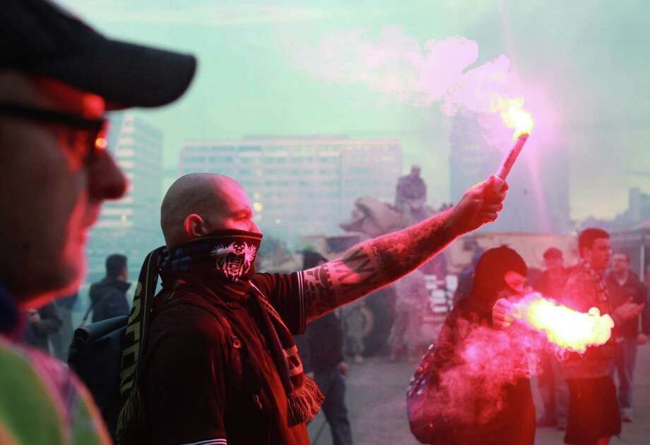 Seattle Sounders fans light road flares before the Seattle Sounders vs. Vancouver Whitecaps game at Centurylink Field on Wednesday, Oct. 8, 2013. Photo: SOFIA JARAMILLO/SEATTLEPI.COM / SEATTLEPI.COM