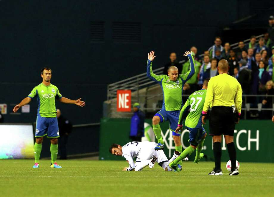 Seattle Sounders midfielder Osvaldo Alonso reacts to a call by the ref during the Seattle Sounders vs. Vancouver Whitecaps game at Centurylink Field on Wednesday, Oct. 8, 2013. Photo: SOFIA JARAMILLO, SOFIA JARAMILLO/SEATTLEPI.COM / SEATTLEPI.COM