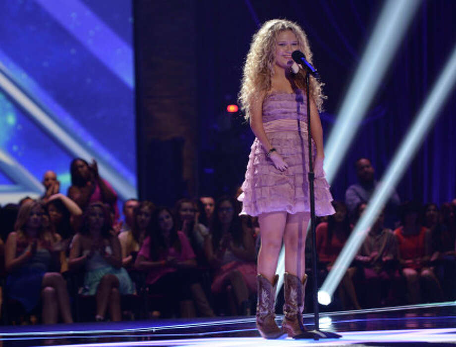 THE X FACTOR: FOUR CHAIR CHALLENGE: Contestant Rionn Paige performs at the FOUR CHAIR CHALLENGE on THE X FACTOR airing Thursday, Oct. 3 (8:00-10:00 PM ET/PT) on FOX.  CR: Michael Becker / FOX. © Copyright 2013 FOX Braodcasting.