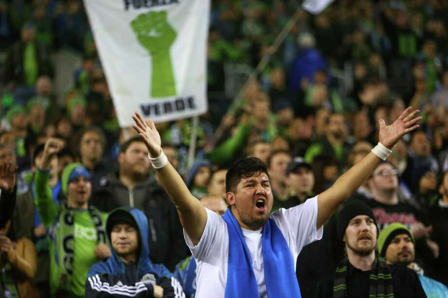 Seattle Sounders fans react as their team falls behind against the Vancouver Whitecaps on Wednesday, October 9, 2013 at CenturyLink Field in Seattle. Photo: JOSHUA TRUJILLO, SEATTLEPI.COM / SEATTLEPI.COM