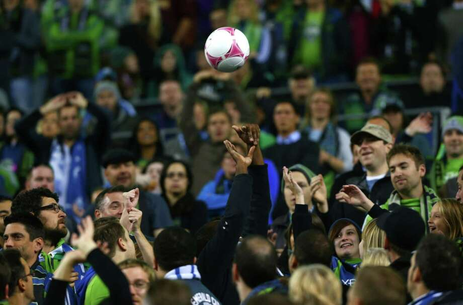 A ball goes into the crowd during a match between the Seattle Sounders and Vancouver Whitecaps on Wednesday, October 9, 2013 at CenturyLink Field in Seattle. Photo: JOSHUA TRUJILLO, SEATTLEPI.COM / SEATTLEPI.COM