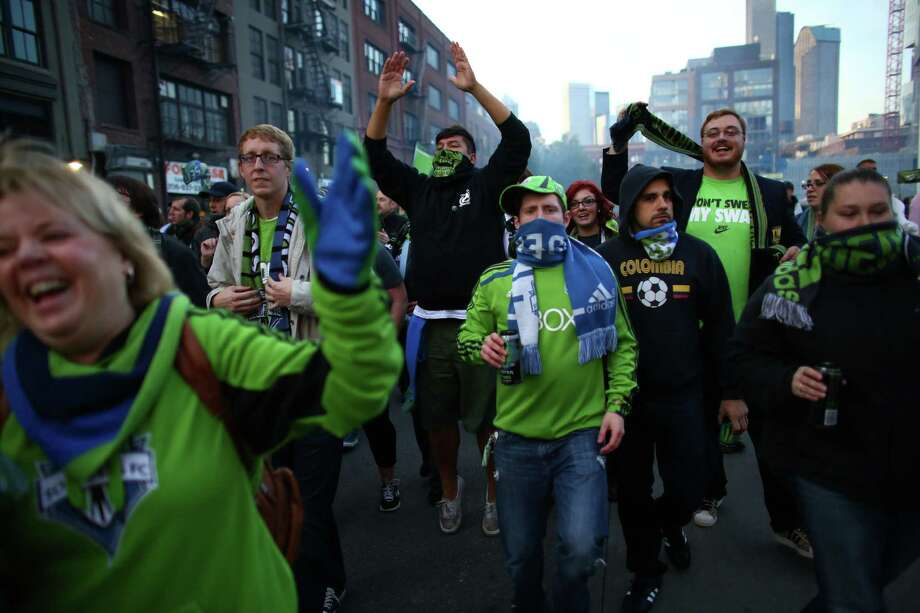 Seattle Sounders fans march to the match against the Vancouver Whitecaps on Wednesday, October 9, 2013 at CenturyLink Field in Seattle. Photo: JOSHUA TRUJILLO, SEATTLEPI.COM / SEATTLEPI.COM
