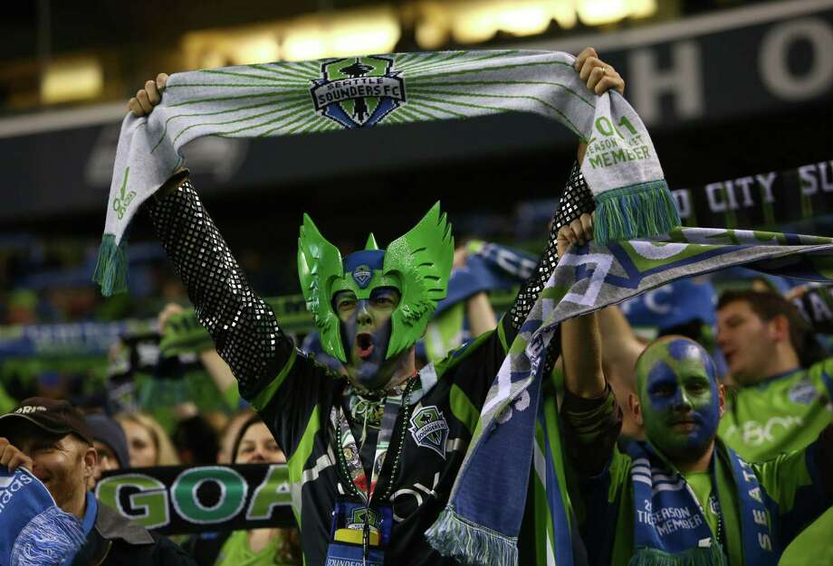 Seattle Sounders fans cheer on their team against the Vancouver Whitecaps on Wednesday, October 9, 2013 at CenturyLink Field in Seattle. Photo: JOSHUA TRUJILLO, SEATTLEPI.COM / SEATTLEPI.COM