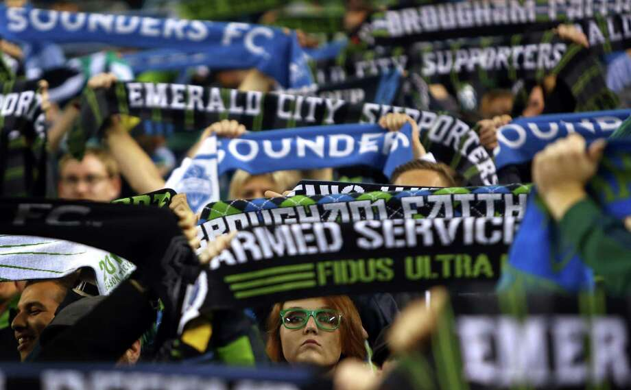 Seattle Sounders fans cheer for their team against the Vancouver Whitecaps on Wednesday, October 9, 2013 at CenturyLink Field in Seattle. Photo: JOSHUA TRUJILLO, SEATTLEPI.COM / SEATTLEPI.COM