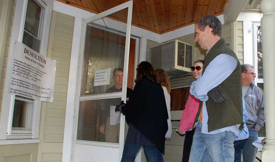 Members of the Representative Town Meeting and the public toured the Gunn House on Church Lane Wednesday, checking out the structure before an Oct. 22 on overturning a Planning and Zoning Commission decision denying plans to relocate it. Photo: Jarret Liotta / Westport News contributed