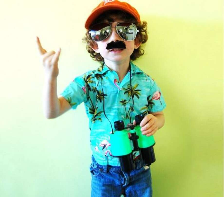 MAGNUM P.I. (2012): We always try to honor a costume with a last-minute feel, and Chris Rooney and his son nailed it with this Magnum P.I costume. The fake mustache is excellent, as is the Detroit Tigers cap. (In Giants colors!) But the kid's enthusiastic expression really sells this thing.