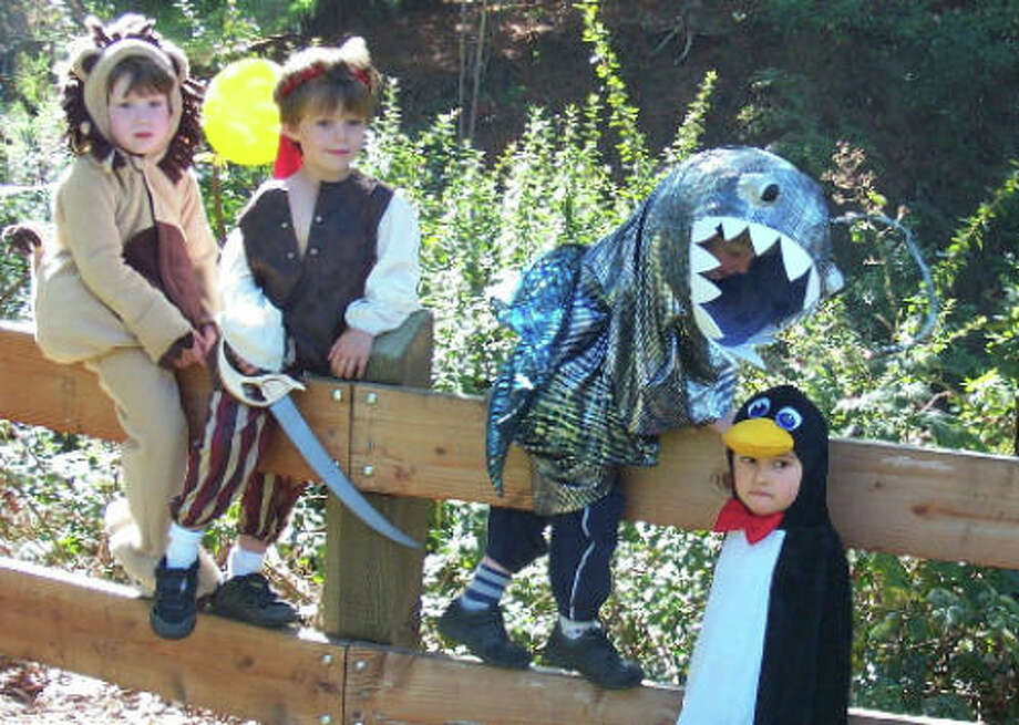 ANGLER FISH (2007): Our earliest Super-Crafty Costume Contest grand prize winner. The light reportedly worked at the end of this predator fish's costume. The penguin is totally unaware of his fate. Pirate and lion aren't getting involved.