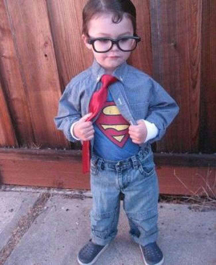 CLARK KENT/SUPERMAN (2011): Once again proving that you can win our contest with a simple costume, as long as your kid can sell it. And at the moment this photo was taken, Griffin believed he was a Crocs-wearing Superman.