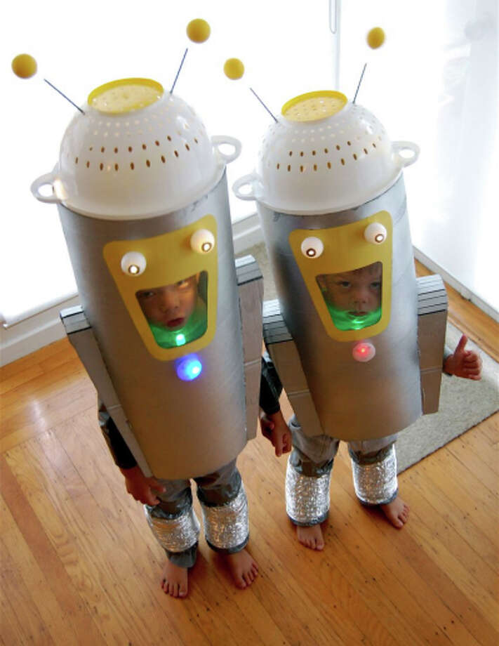 "ROBOTS (2010): Short of having a ""Mythbuster"" for a father, it's hard to imagine a more awesome costume-maker for a dad than Otto Williams. Bonus points because the siblings are holding hands."